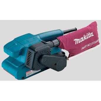 Makita 9911 pásová brúska s konštrukciou umožňujúcou brúsiť až po okraj